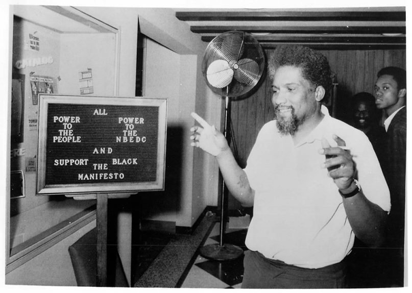 James Forman, chief spokesman for the Black Manifesto, inspects a bulletin board in New York's Interchurch Center after he and supporting members of the National Black Economic Development Conference seized three floors of offices in 1969. The NBEDC sought $500 million in reparations from the white religious community. RNS file photo