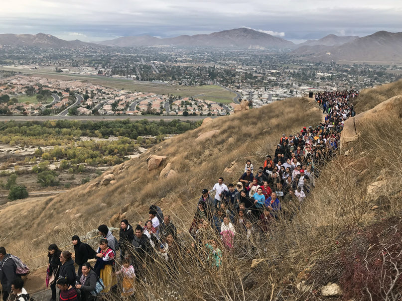 Hundreds of people hike up Mount Rubidoux, in Riverside, California, as part of a 2.5-mile pilgrimage to celebrate the Virgin Mary on Dec. 7, 2019. RNS photo by Alejandra Molina