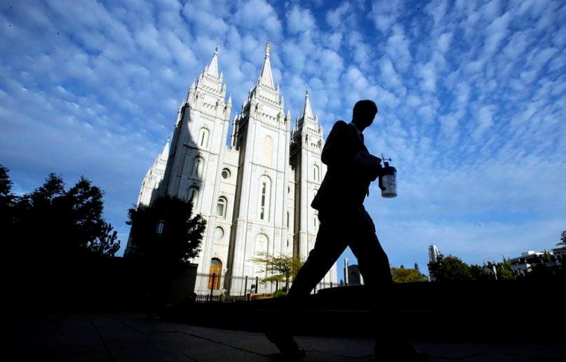 A man walks past the Salt Lake Temple at Temple Square in Salt Lake City on Sept. 14, 2016. (AP Photo/Rick Bowmer)