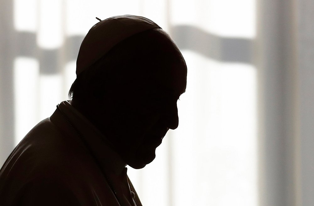 Pope Francis is silhouetted during a private audience at the Vatican on Dec. 14, 2019. (Yara Nardi/Pool photo via AP)
