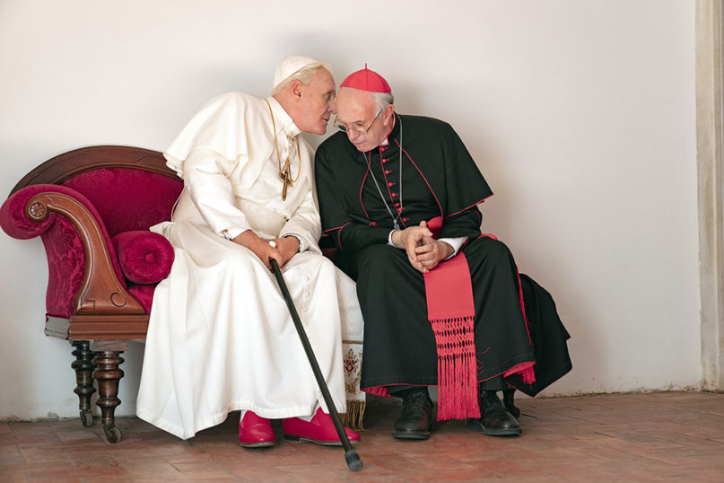 Jonathan Pryce as Cardinal Bergoglio, right, and Anthony Hopkins as Pope Benedict in a scene from
