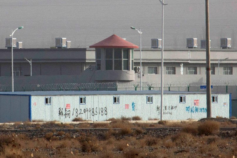 In this Dec. 3, 2018, file photo, a guard tower and barbed wire fences are seen around a facility in the Kunshan Industrial Park in Artux in western China's Xinjiang region. The U.S. considers facilities like this to be detention camps for Uyghur Muslims. (AP Photo/Ng Han Guan, File)