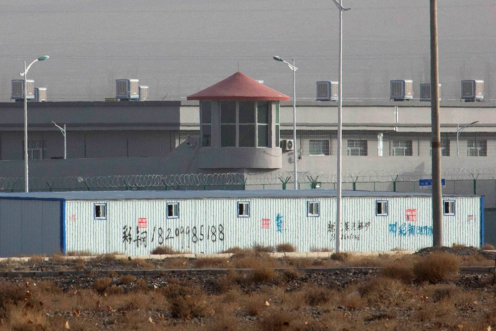 In this Dec. 3, 2018, file photo, a guard tower and barbed wire fences are seen around a facility in the Kunshan Industrial Park in Artux in western China's Xinjiang region. The U.S. considers facilities like this to be detention camps for Uighur Muslims. (AP Photo/Ng Han Guan, File)