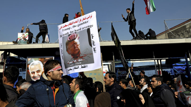 Mourners attend a funeral ceremony for Iranian Gen. Qassem Soleimani and his comrades, who were killed in Iraq in a U.S. drone strike on Friday, at the Enqelab-e-Eslami (Islamic Revolution) square in Tehran, Iran, Monday, Jan. 6, 2020. The processions mark the first time Iran honored a single man with a multi-city ceremony. Not even Ayatollah Ruhollah Khomeini, who founded the Islamic Republic, received such a processional with his death in 1989. Soleimani on Monday will lie in state at Tehran's famed Musalla mosque as the revolutionary leader did before him. (AP Photo/Ebrahim Noroozi)