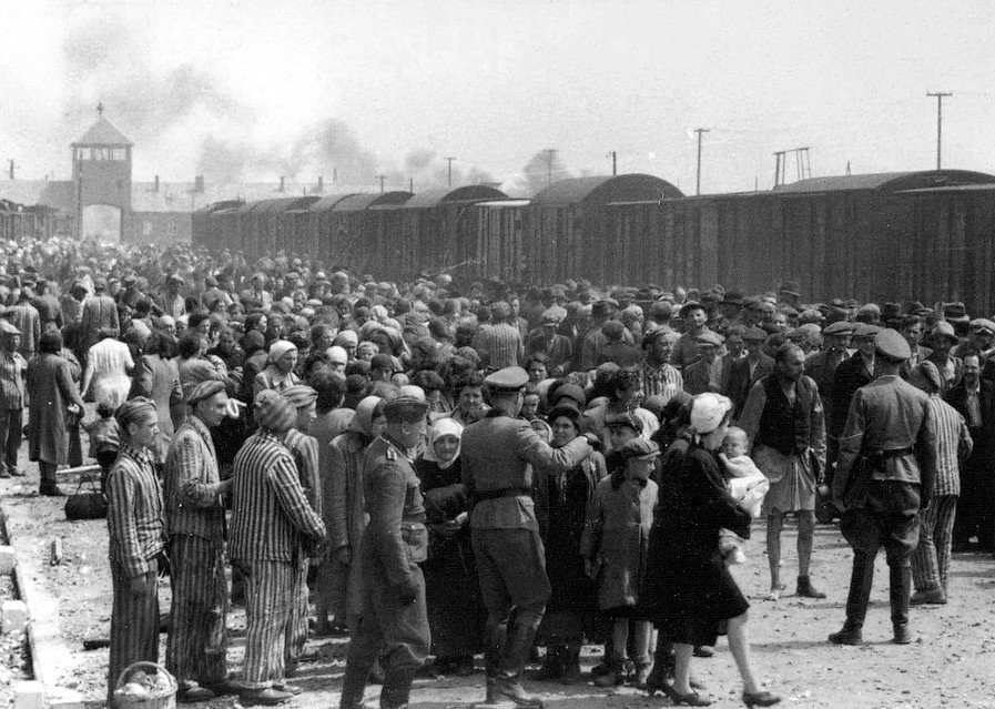 """""""Selection"""" of Hungarian Jews on the ramp at Auschwitz-II (Birkenau), in Nazi-occupied Poland, during the Holocaust in May/June 1944. Jews were sent either to work or to the gas chamber. The photograph is part of the collection known as the Auschwitz Album/Creative Commons"""