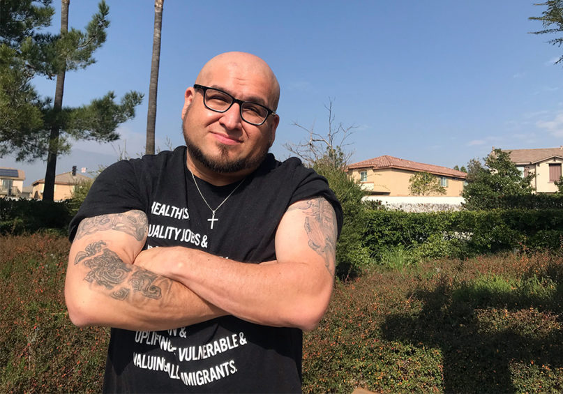 Allen Hernandez's arm tattoos illustrate his shared Christian and indigenous identity. RNS photo by Alejandra Molina