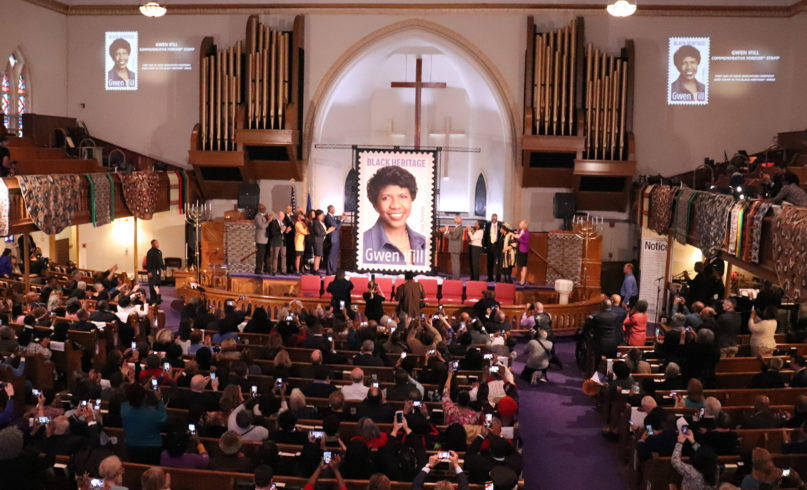 Attendees applaud and take photos during an unveiling ceremony for the new USPS Black Heritage stamp of Gwen Ifill at Metropolitan African Methodist Episcopal Church in Washington on Jan. 30, 2020. RNS photo by Adelle M. Banks
