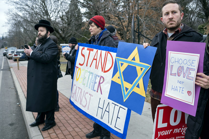Neighbors gather to show their support of the community near a rabbi's residence in Monsey, New York, on Dec. 29, 2019, after a stabbing during a Hanukkah celebration. (AP Photo/Craig Ruttle)