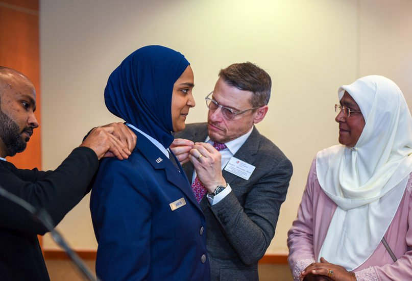 Friends and family members of Chaplain Candidate Saleha Jabeen pin on her second lieutenant rank during a commissioning ceremony, Dec. 18, 2019, at the Catholic Theological Union in Chicago. Jabeen is the first female Muslim Chaplain in the Air Force and Department of Defense. (U.S. Air Force photo/ Tech. Sgt. Armando A. Schwier-Morales)