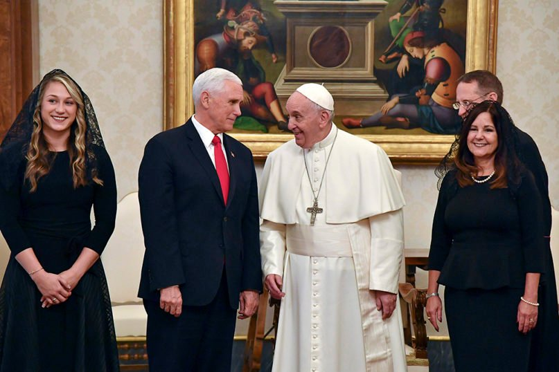 """Pope Francis shares a word with Vice President Mike Pence, second from left, his wife Karen, right, and their daughter-in-law Sarah, on the occasion of their private audience, at the Vatican, Friday, Jan. 24, 2020. Pence told Pope Francis, """"You made me a hero"""