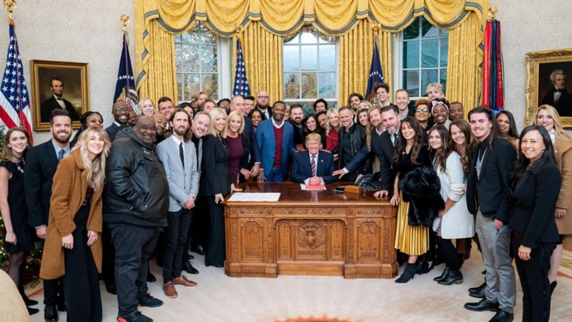Evangelical worship leaders from across the country surround President Donald Trump for a photo in the Oval Office on Dec. 6, 2019. (Official White House Photo by Tia Dufour/Creative Commons)