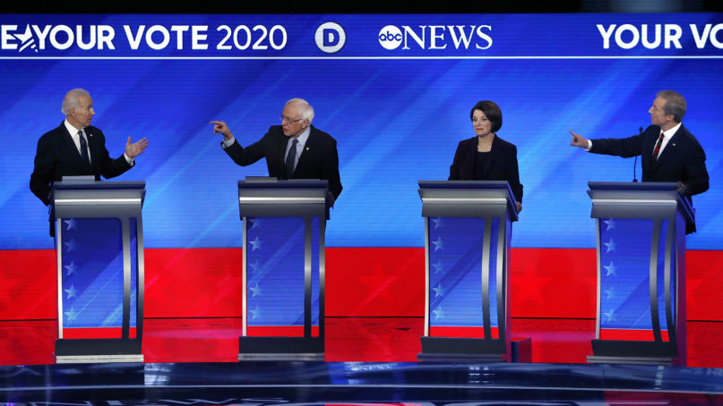 Democratic presidential candidates former Vice President Joe Biden, from left; Sen. Bernie Sanders, I-Vermont; Sen. Amy Klobuchar, D-Minnesota; and businessman Tom Steyer participate in a Democratic presidential primary debate Feb. 7, 2020, hosted by ABC News, Apple News and WMUR-TV at St. Anselm College in Manchester, New Hampshire. (AP Photo/Elise Amendola)
