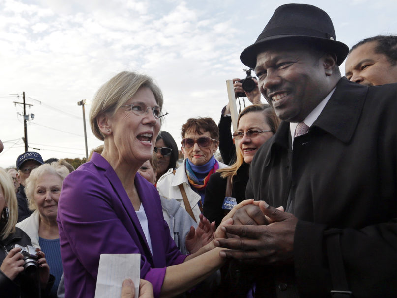 In this 2012 file photo, Democratic candidate for U.S. Senate Elizabeth Warren, left, shakes hands with the Rev. Miniard Culpepper during a campaign event in Brockton, Massachusetts, on Nov. 1, 2012. (AP Photo/Elise Amendola)