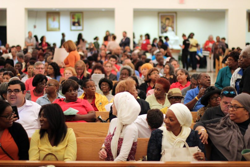 Attendees mingle before the start of the 2018 Nehemiah Action Assembly at Notre Dame d'Haiti Catholic Church in March 2018 in Miami. Photo by Micah Fae Photography