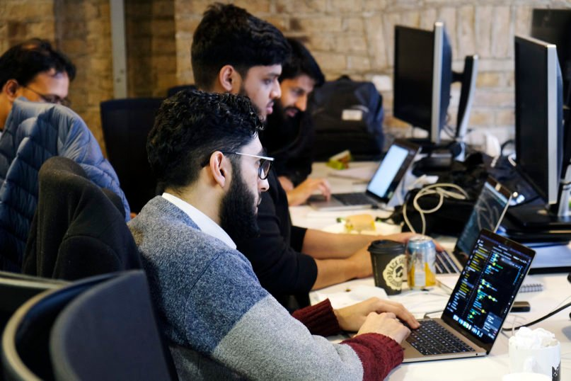 Participants at the Islamic Education in the 21st Century hackathon work on developing the Khaldun app in London on Jan. 26, 2020. RNS photo by Aysha Khan