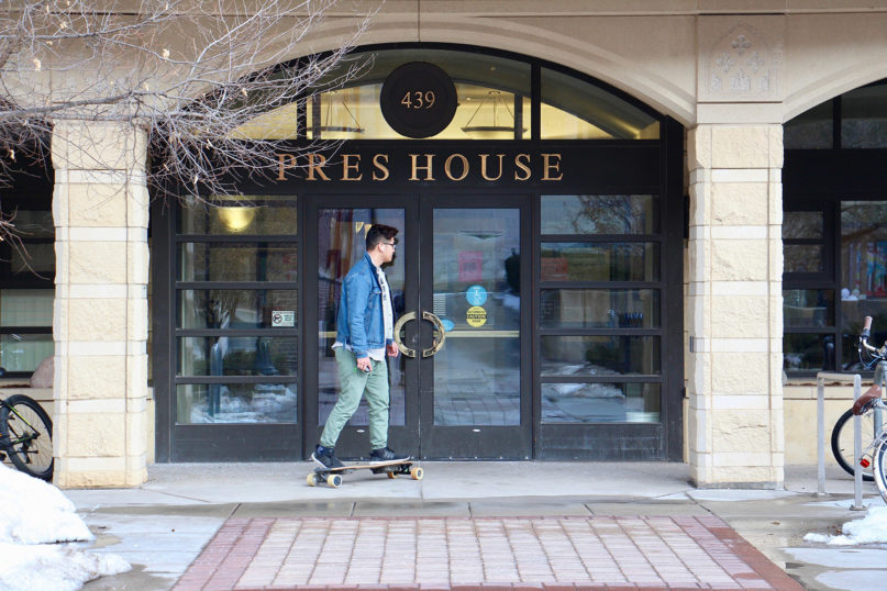 A skateboarder arrives at Pres House Apartments, which stand on what used to be the parking lot of Pres House, the campus ministry of the Presbyterian Church (U.S.A.) at the University of Wisconsin-Madison. RNS photo by Emily McFarlan Miller