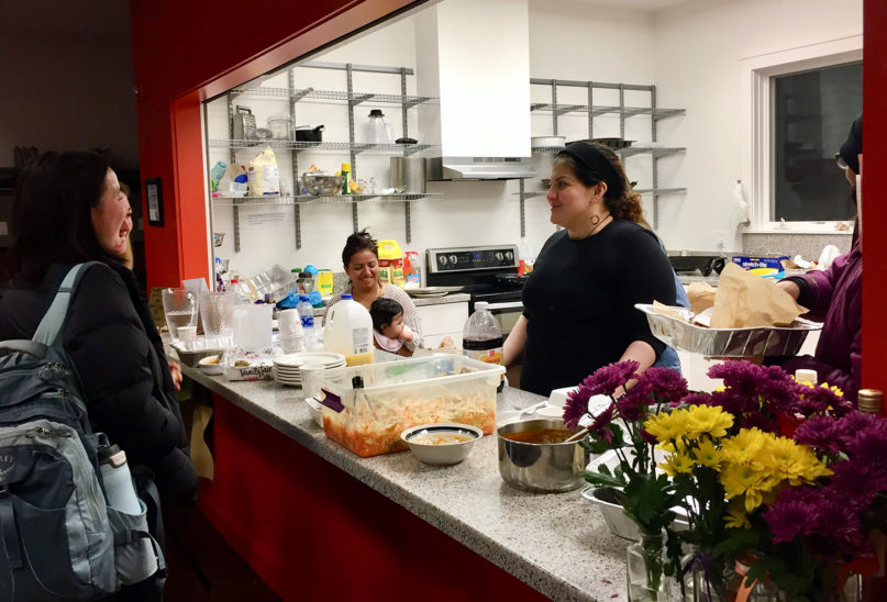 Rosa del Carmen Ortez-Cruz, right, prepares pupusas for church friends, Thursday, Feb. 27, 2020, after receiving news that a federal court has protected her from deportation. She has been living at Church of Reconciliation in Chapel Hill, North Carolina, for 22 months. RNS photo by Yonat Shimron