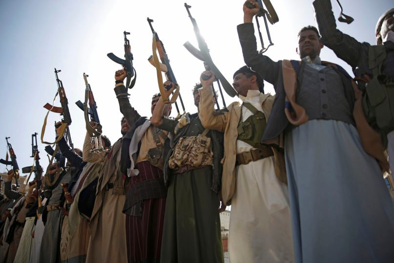 Houthi rebel fighters chant slogans as they hold their weapons during a gathering aimed at mobilizing more fighters for the Iranian-backed Houthi movement, in Sanaa, Yemen, Thursday, Feb. 20, 2020. The Houthi rebels control the capital, Sanaa, and much of the country's north, where most of the population lives. They are at war with a U.S.-backed, Saudi-led coalition fighting on behalf of the internationally recognized government. (AP Photo/Hani Mohammed)