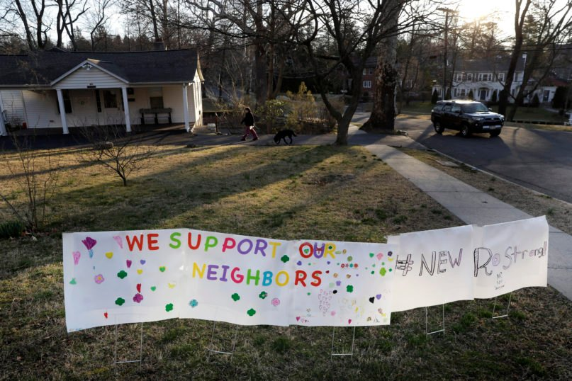 A sign showing support for residents is displayed on a lawn in New Rochelle, New York, on March 11, 2020. State officials are shuttering several schools and houses of worship for two weeks in the New York City suburb and sending in the National Guard to help with what appears to be the nation's biggest cluster of coronavirus cases, Gov. Andrew Cuomo said Tuesday. (AP Photo/Seth Wenig)