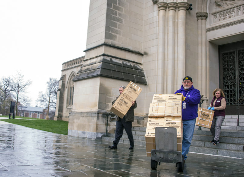 Boxes of N95 respiratory masks are brought out of Washington National Cathedral to be donated to two Washington hospitals on March 25, 2020. Photo by Danielle E. Thomas/Washington National Cathedral