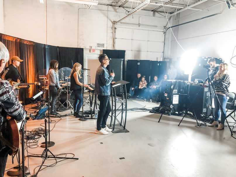 City Light Church pastor Jason Rollin, center, speaks as the production team livestreams a service from a warehouse in Rochester Hills, Michigan, Sunday, March 15, 2020. Photo courtesy of City Light Church