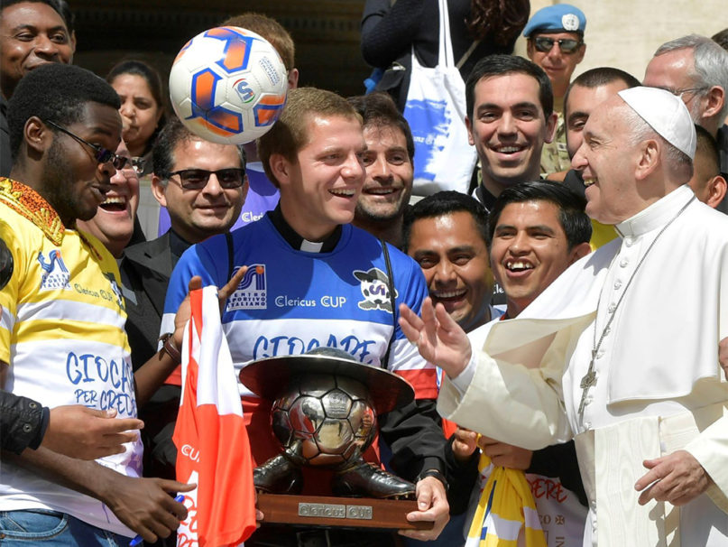 Pope Francis plays with a soccer ball as he meets players of the Clericus Cup, a soccer tournament by teams of Catholic seminarians in Rome, at the end of his weekly general audience, in St. Peter's Square at the Vatican, Wednesday, May 29, 2019. Photo courtesy of Clericus Cup