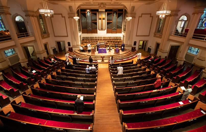 Worship in a mostly empty sanctuary at Belmont United Methodist Church in Nashville, Tennessee, March 15, 2020, at the beginning of the pandemic. Photo by Mike DuBose, UM News