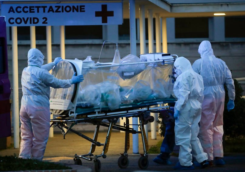 A patient in a biocontainment unit is moved on a stretcher at the Columbus Covid 2 Hospital in Rome on March 16, 2020. (AP Photo/Alessandra Tarantino)