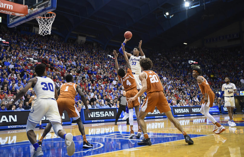 Kansas Jayhawks forward David McCormack (33) shoots over the Texas defense during the second half of an NCAA college basketball game at Allen Fieldhouse in Lawrence, Kansas, Monday, Feb. 3, 2020. (AP Photo/Reed Hoffmann)