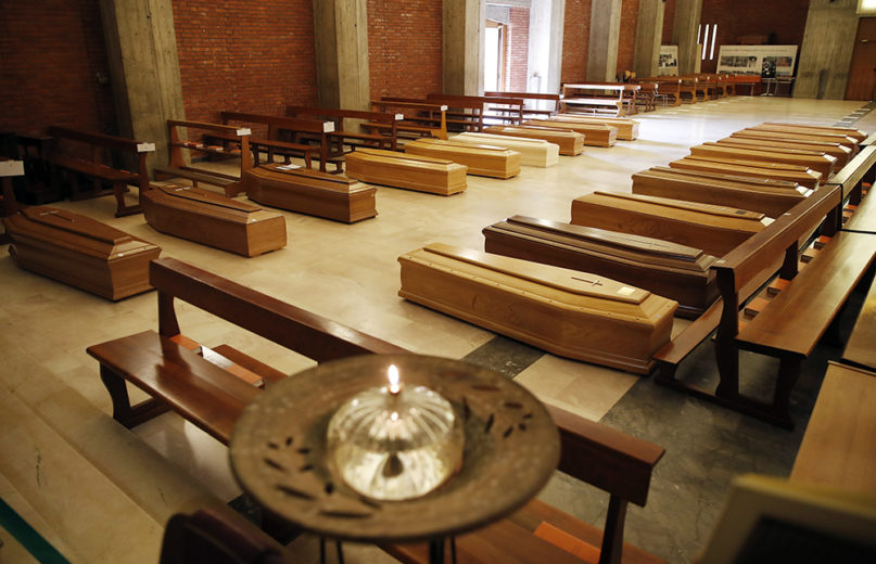 Coffins are lined up on the floor in the San Giuseppe church in Seriate, one of the areas worst hit by coronavirus, near Bergamo, Italy, waiting to be taken to a crematory, on March 26, 2020. (AP Photo/Antonio Calanni)
