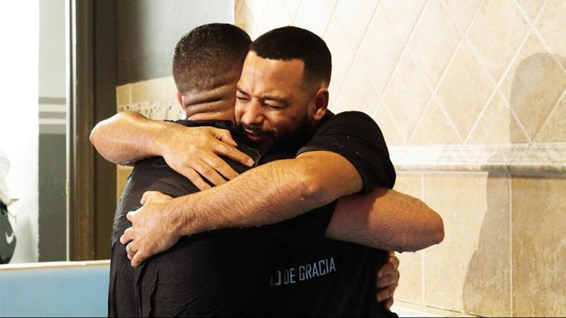 Pastor Kerlin Calderon, right, hugs a newly baptized congregant at Grace Tabernacle NYC, Feb. 29, 2020, in the Bronx. Photo courtesy of Grace Tabernacle NYC