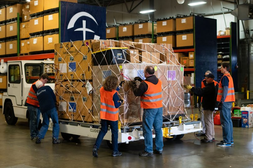 Samaritan's Purse workers pack medical equipment, including a 68-bed emergency field hospital, on March 16, 2020, in Greensboro, North Carolina, to be airlifted to northern Italy to aid those impacted by the coronavirus. Photo courtesy of Samaritan's Purse