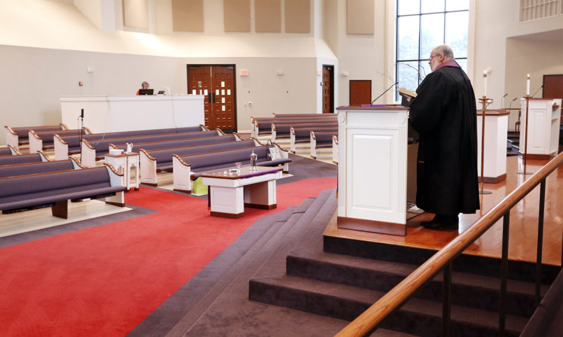 The Rev. Kip Rush delivers his sermon in a sanctuary filled with mostly empty pews March 15, 2020, during a streamed service at Brenthaven Cumberland Presbyterian Church in Brentwood, Tennessee. (AP Photo/Mark Humphrey)