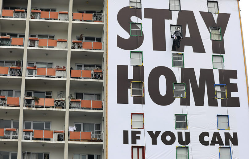 A billboard is installed on an apartment building in Cape Town, South Africa, Wednesday, March 25, 2020. On Thursday, the country of 57 million people began a nationwide lockdown for 21 days to fight the spread of the new coronavirus. (AP Photo/Nardus Engelbrecht)