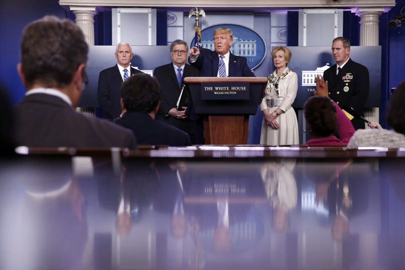 President Donald Trump takes questions from reporters as he speaks about the coronavirus in the James Brady Briefing Room on March 23, 2020, in Washington. (AP Photo/Alex Brandon)