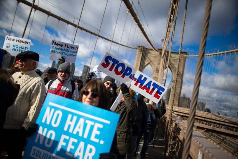 People take part in a march crossing the Brooklyn Bridge in solidarity with the Jewish community after recent string of anti-semitic attacks throughout the greater New York area, on Sunday, Jan. 5, 2020 in New York.(AP Photo/Eduardo Munoz Alvarez)