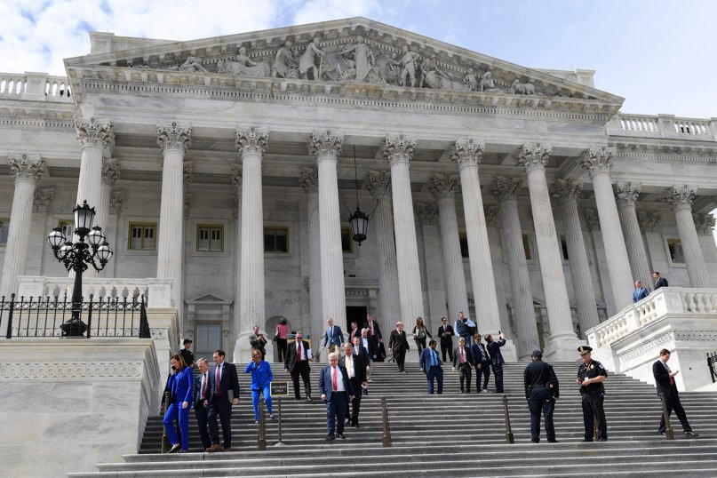 Members of the House of Representatives walk down the steps of Capitol Hill in Washington on March 27, 2020, after passing a coronavirus rescue package known as the CARES Act. The House rushed President Donald Trump a $2.2 trillion rescue package, tossing a life preserver to a U.S. economy and health care system left flailing by the coronavirus pandemic. The Paycheck Protection Program was part of the CARES Act. (AP Photo/Susan Walsh)
