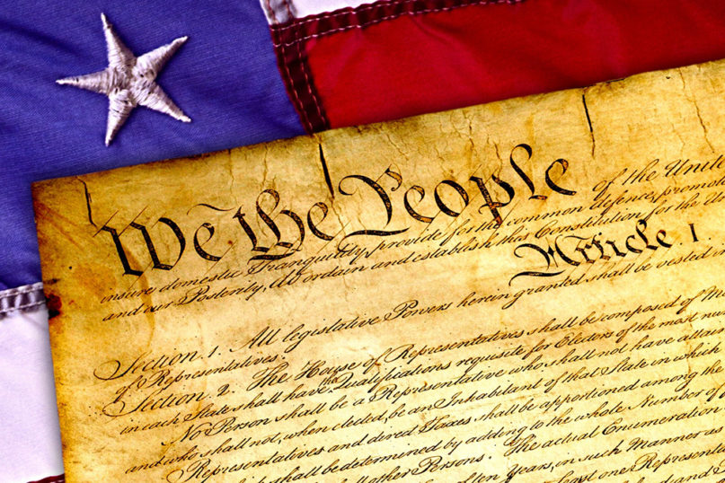A copy of the U.S. Constitution on the flag. Image by Wynn Pointaux/Pixabay/Creative Commons