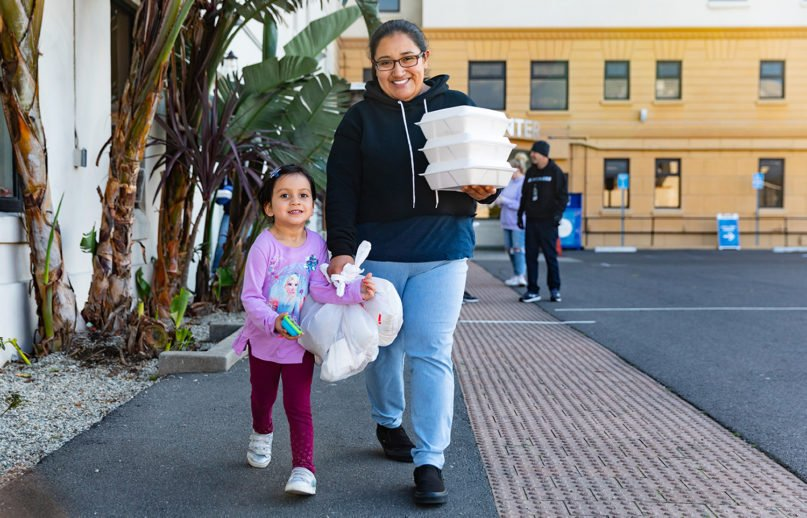 People carry free meals away from the Dream Center, in the Echo Park neighborhood of Los Angeles. Dream Center is the nonprofit of Pentecostal megachurch Angelus Temple. Photo courtesy of Dream Center
