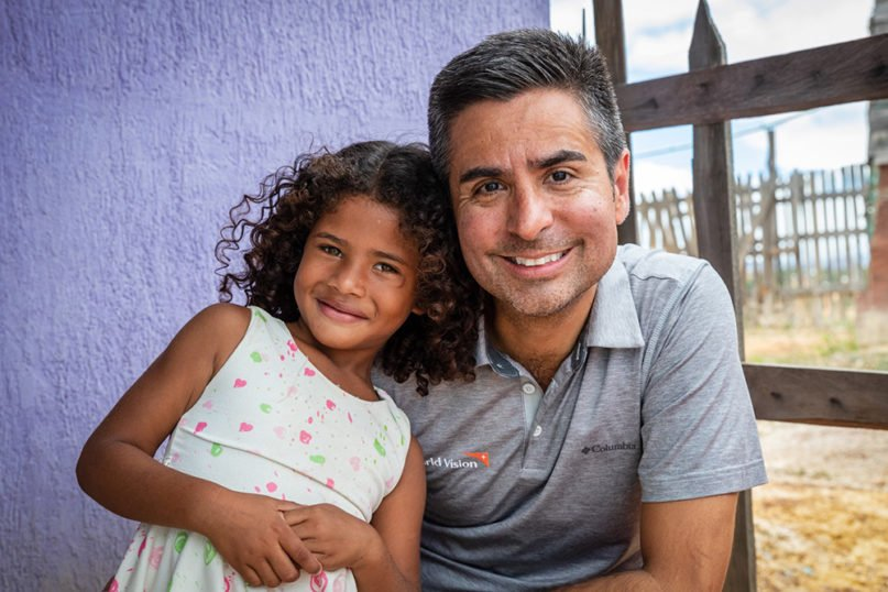 World Vision U.S. President Edgar Sandoval Sr. poses with a young Venezuelan migrant. Photo courtesy of World Vision