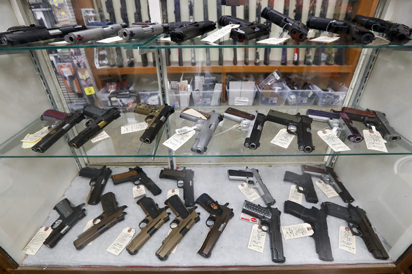 Semiautomatic handguns are displayed at Duke's Sport Shop on March 25, 2020, in New Castle, Pennsylvania. (AP Photo/Keith Srakocic)