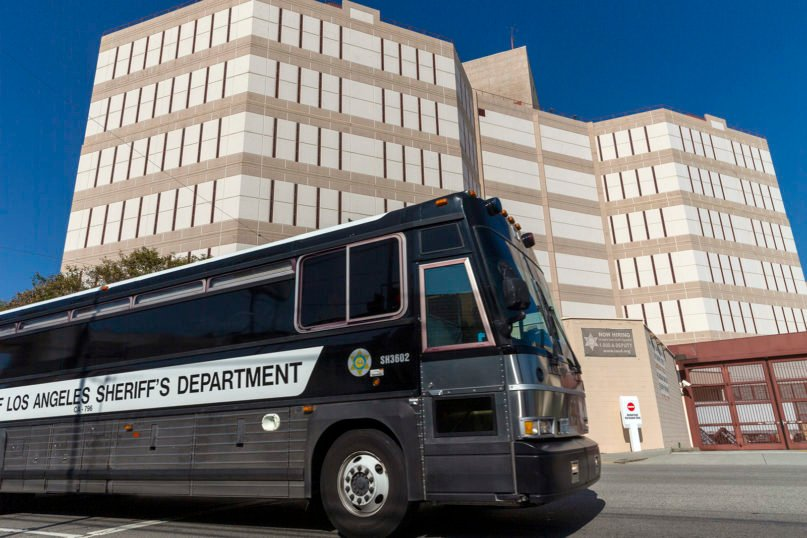 A Los Angeles County Sheriff's Department prisoner transportation bus leaves the Twin Towers Correctional Facility in Los Angeles on April 1, 2020. California is planning to release within days as many as 3,500 inmates who were due to be paroled in the next two months as it tries to free space in cramped prisons in anticipation of a coronavirus outbreak, state officials said Tuesday. (AP Photo/Damian Dovarganes)