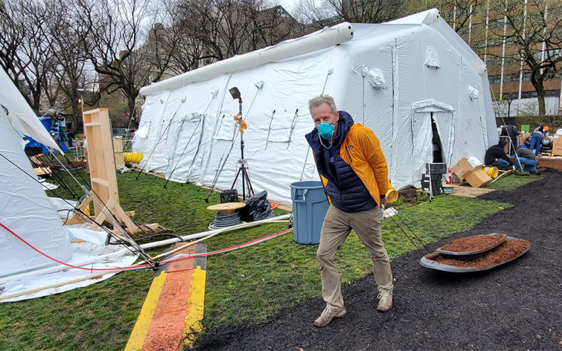 Volunteer Whitney Tilson pulls mulch through the Samaritan's Purse field hospital in Central Park, March 31, 2020, in New York. Courtesy photo