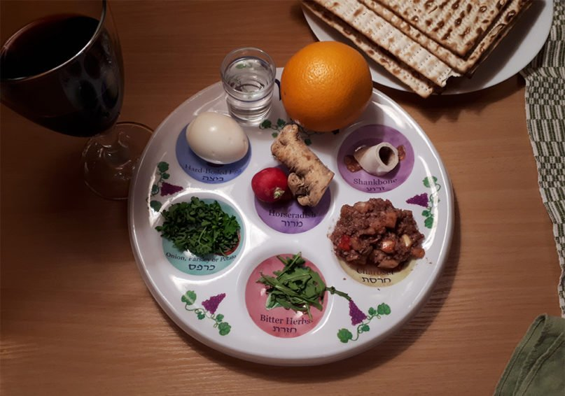 A Passover Seder plate with wine and matzo. Photo by Mikael Häggström/Creative Commons