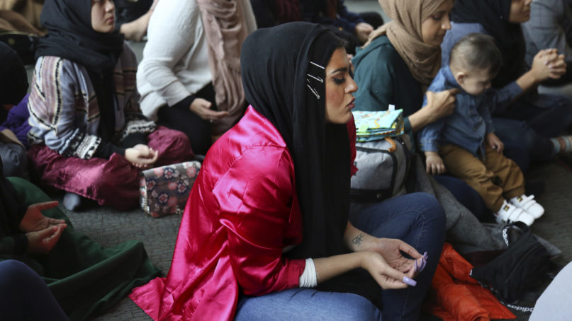Amani Al-Khatahtbeh, center, at the Islamic Center of New York University during jumah, also known as Friday prayer, on Dec. 27, 2019, in New York City's Greenwich Village. (AP Photo/Jessie Wardarski)