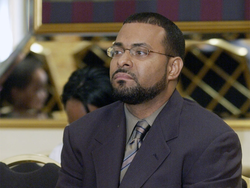 Imam Earl Abdulmalik Mohammed listens to a news conference during the Islamic Convention of the American Society of Muslims at a Chicago hotel, Thursday, August 28, 2003.  (AP Photo/Stephen J. Carrera)