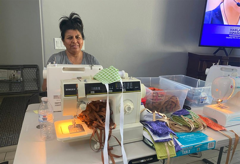 Maria helps produce face masks for The Mask Project, in Phoenix, on May 7, 2020. Photo by Eddie Chavez Calderon