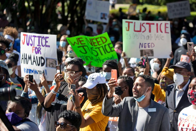 People participate in a rally May 8, 2020, in Brunswick, Georgia, to protest the killing of Ahmaud Arbery, an unarmed black man. Two men have been charged with murder in the February shooting death of Arbery, whom they had pursued in a truck after spotting him running in their neighborhood. (AP Photo/John Bazemore)