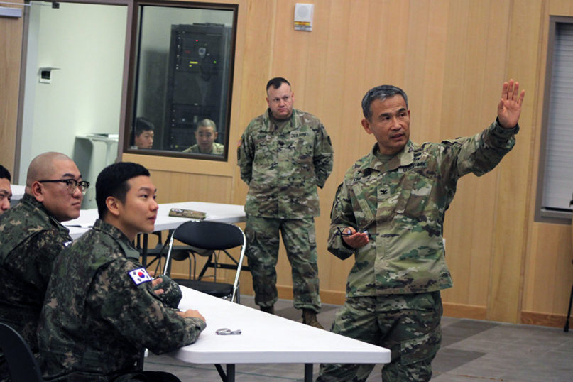 Col. Moon H. Kim, right, Camp Humphreys garrison chaplain, teaches Republic of Korea Army chaplains about logistics and religious support, Nov. 7, 2019, at Four Chaplains Memorial Chapel on Camp Humphreys, South Korea. U.S Army photo, 2nd Infantry Division/Creative Commons