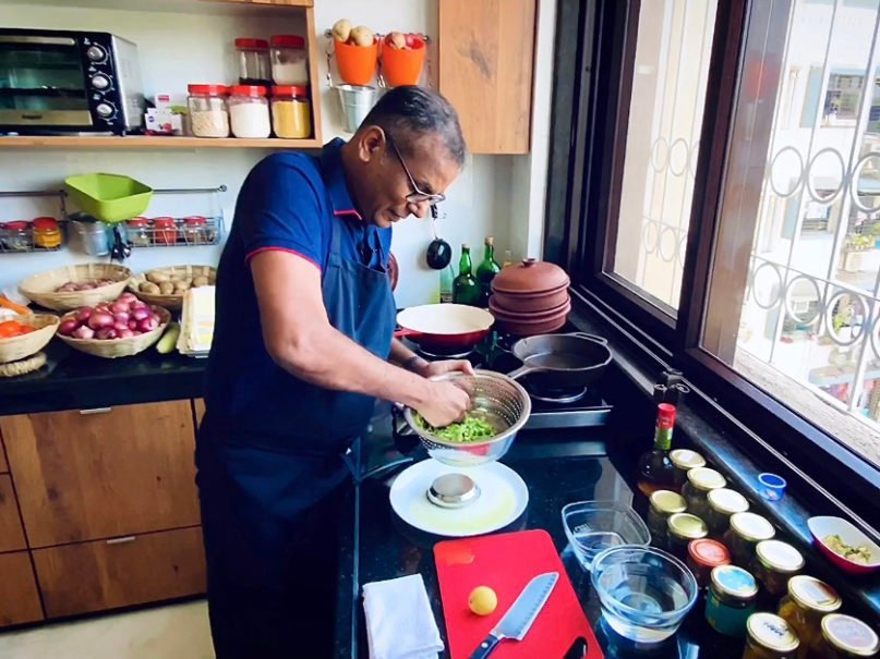 The Rev. Warner D'Souza prepares a lockdown meal in his kitchen using fresh home-grown spices and herbs in Mumbai, India. Photo by Shaliesh Shetty